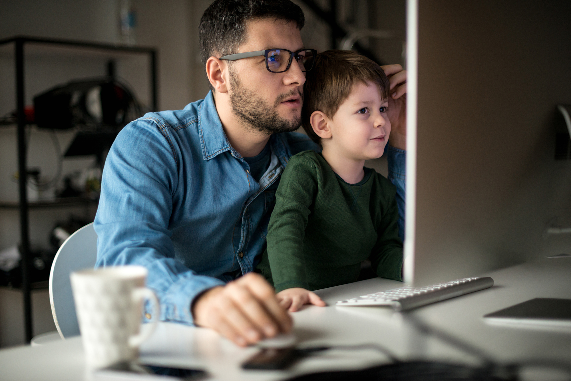 Dad sharing his online course with young son
